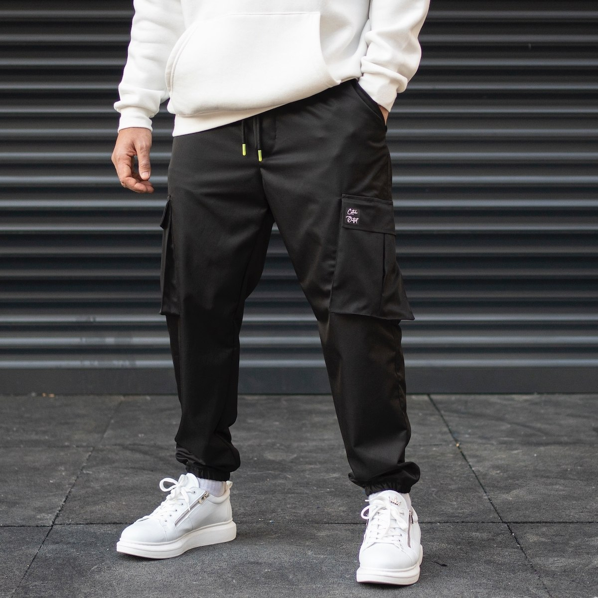 Men's Cargo Pocket Oversize Jogger Jeans With Text Detail And Elastic Hem In Black