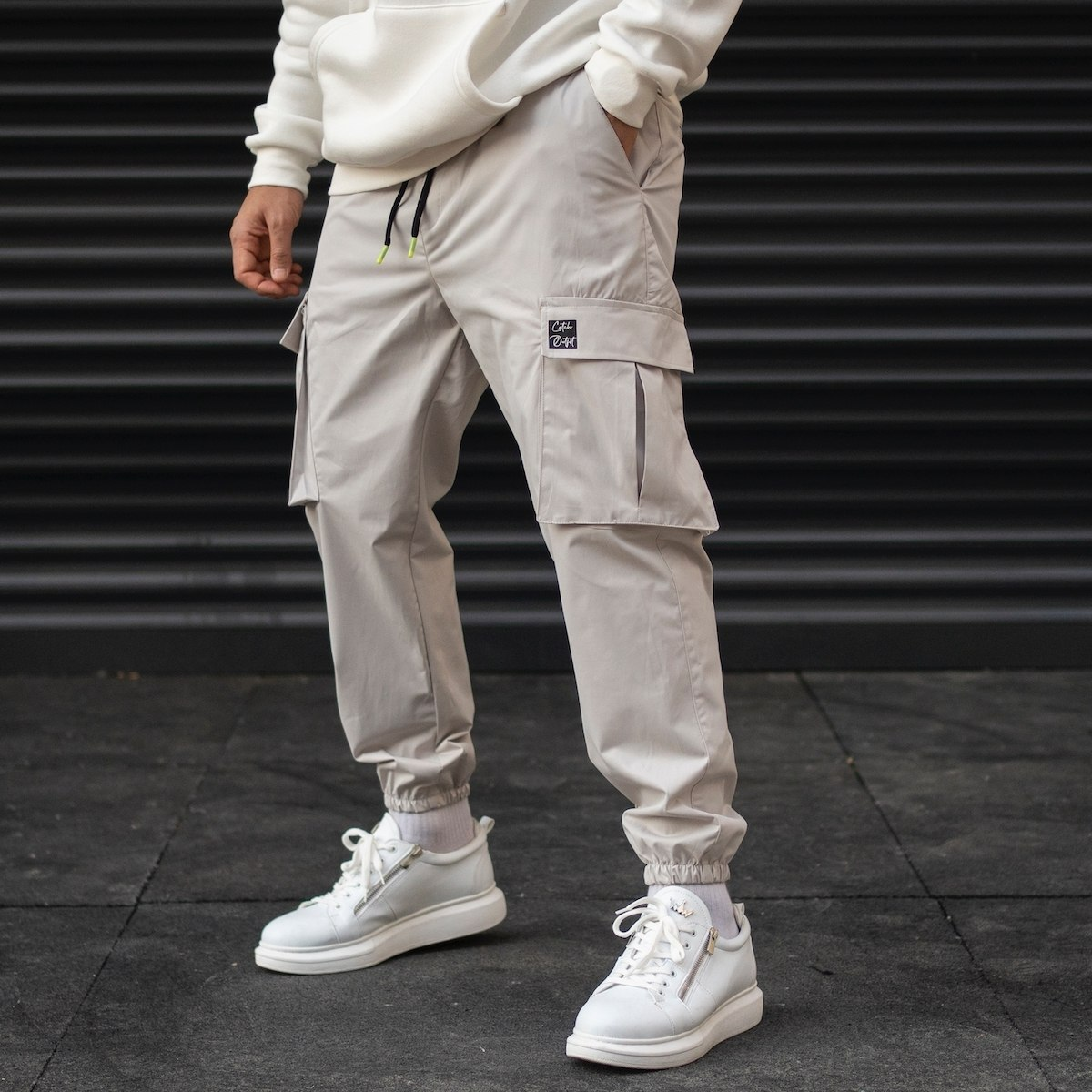 Men's Cargo Pocket Oversize Jogger Jeans With Text Detail And Elastic Hem In Beige